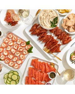 An Acme Smoked Fish collection of smoked whitefish salad, smoked salmon candy, smoked salmon pinwheels, and classic smoked salmon.