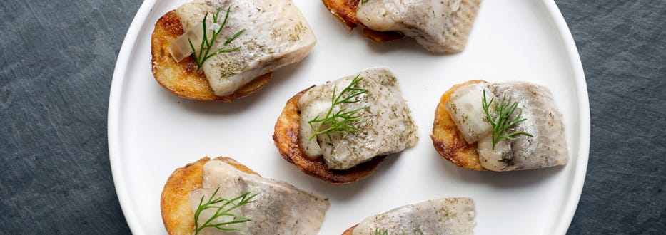 Crispy Baby Potatoes with Pickled Herring and Dill